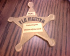 """Flu Fighter"" badges from the public relations office to promote influenza vaccination"