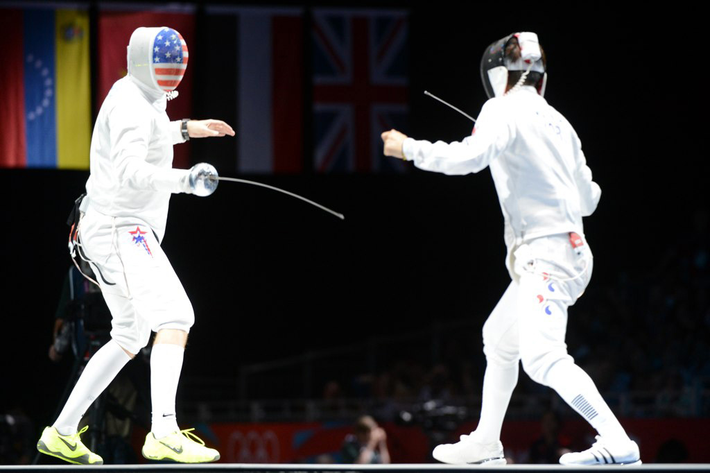 U.S. Air Force Capt. Seth Kelsey, left, competes in the Olympic men's epee individual bronze medal fencing match against Jung Jinsun from South Korea Aug. 1, 2012, at ExCel South Arena in London. Jung defeated Kelsey in sudden-death overtime 12-11. (DoD photo by Tim Hipps, U.S. Army/Released)