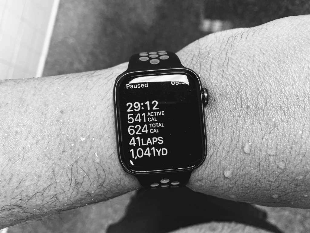 Image of an Apple smart watch showing the statistics for a 1,041 yard swim done in 29 minutes, 12 seconds, burning 541 active calories and 624 total calories in 41 laps.